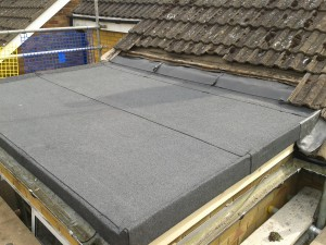 Built up felt flat roof. Using a 3 ply system this high perfomance flat roof should last 15-30 years