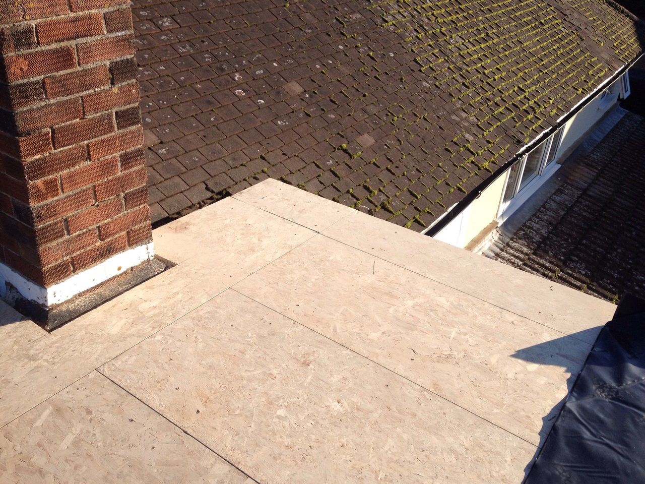 There Is A Chimney Going Through Part Of This Flat Roof, We Will Board  Around